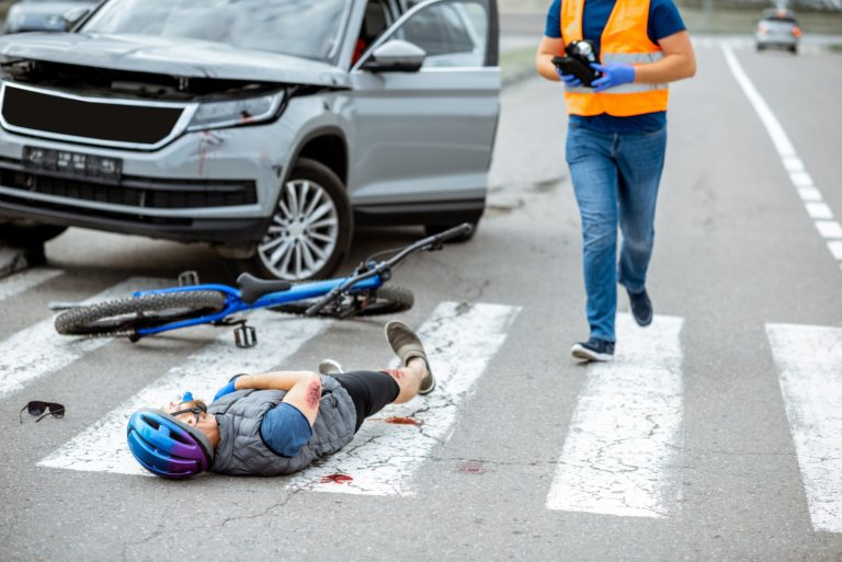Road accident with injured cyclist and car driver